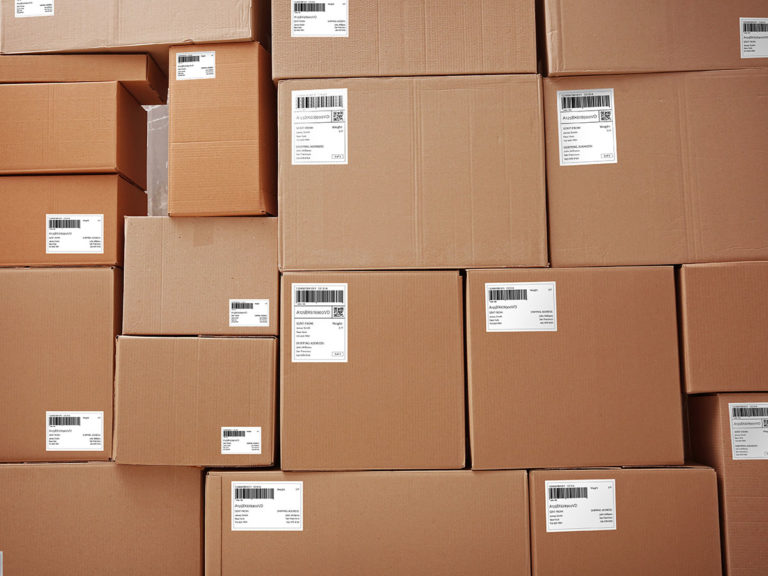 Parcels with tracking codes, closeup